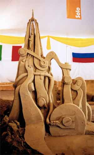 completed sand sculpture electric feather